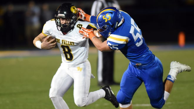 Caleb Craig fights off a defender during Tri-Valley's 30-7 win against host Maysville on Friday night.