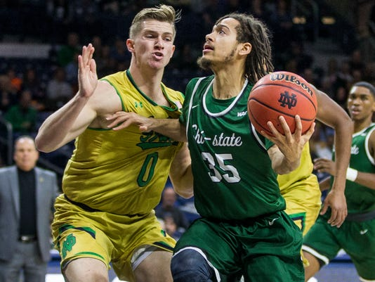 Chicago State's RobShaw (35) drives by Notre Dame's Rex Pflueger (0) during the first half of an NCAA college basketball game Thursday, Nov. 16, 2017, in South Bend, Ind. (AP Photo/Robert Franklin)