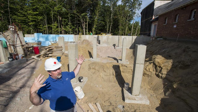 Brian Donahue of Vermont Public Radio gives a tour of the construction site where VPR is expanding its headquarters in Colchester.
