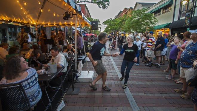 Pierre Swick and Laurie Hurowitz of Waitsfield dance on Church Street at Jenni Johnson sings at Leunig's Bistro and Cafe on the opening night of the Discover Jazz Festival in Burlington on Friday, June 3, 2016.