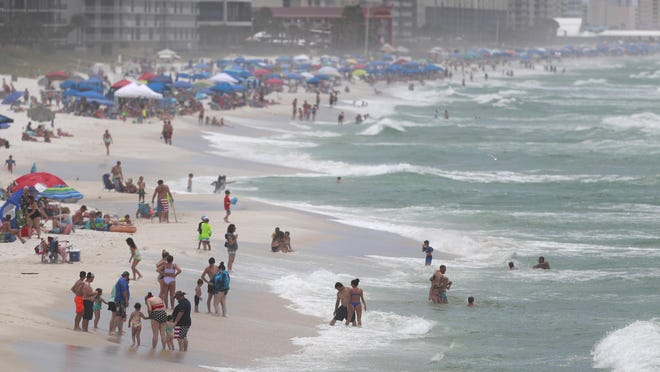Double red flags flew over the beach on July 24, 2020 in Panama City Beach because of rough surf conditions.