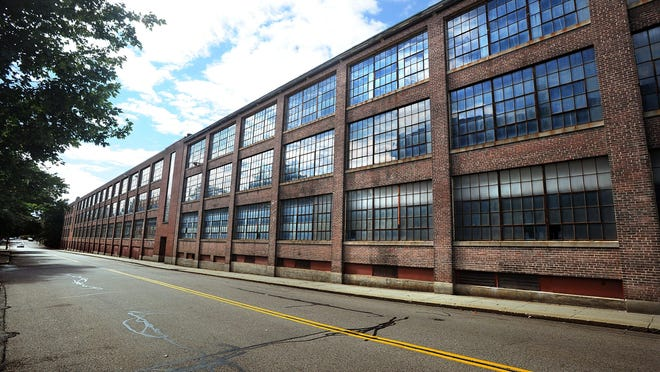A section of the old Draper factory buildings in downtown Hopedale is slated for demolition after it was determined to have structural and environmental problems.