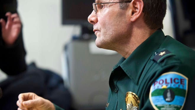 Tim Bilodeau, deputy chief for the University of Vermont's Police Services, describes at a news conference in Burlington on Wednesday, December 10, 2014, how a pet chicken belonging to UVM's Alpha Gamma Rho fraternity was stolen and eaten by three UVM students.