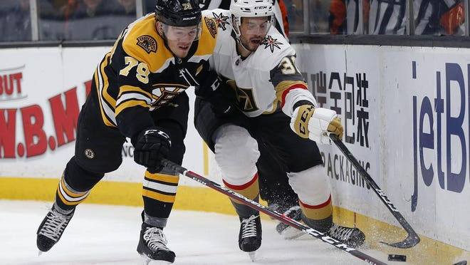 When the Bruins resume their season in a few weeks, the partner for Matt Grzelcyk on the No. 3 defensive line is likely to be Jeremy Lauzon, left, shown battling for the puck with the Vegas Golden Knights' Tomas Hyka at TD Garden.