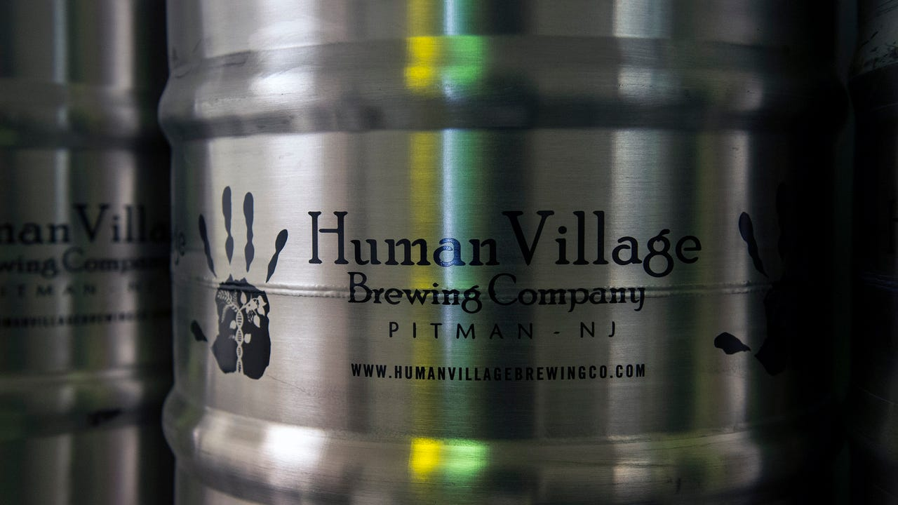 Human Village Brewing Company's Emily Barnes, left, and Megan Myers discuss plans for their new brewery Tuesday, June 14 in Pitman.