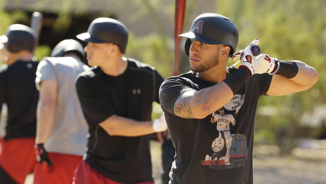 Arizona Diamondbacks' David Peralta looks at live pitches at spring training camp on Feb. 15, 2017 at Salt River Fields in Scottsdale, Ariz.