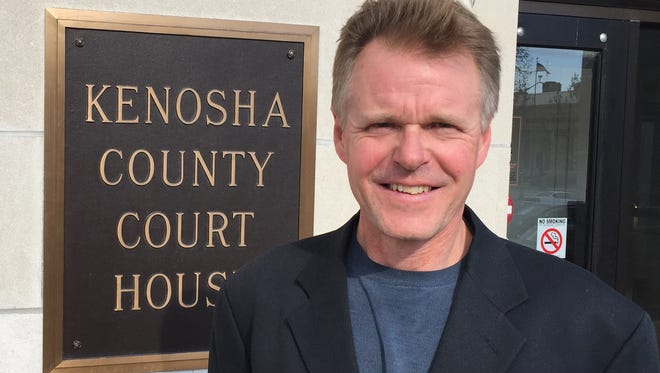 Guy Smith stands outside of the Kenosha County Courthouse.