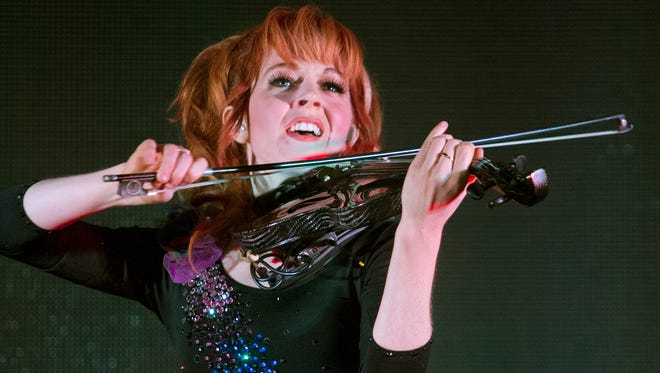 Lindsey Stirling wields a rapidfire bow onstage at the Marquee Theatre during her concert , Tuesday, May 27, 2014.  The Gilbert woman has her latest album debuting at number 2.