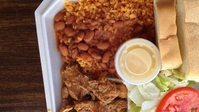 The stewed pork dinner at El Pilón Criollo is incredibly tender, and tasty.