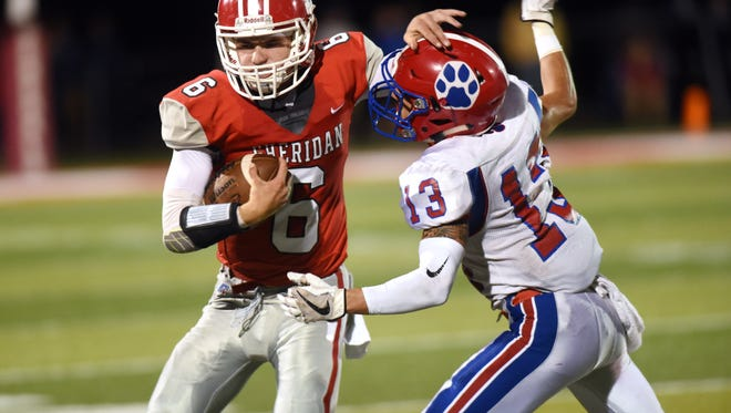 Sheridan quarterback Ethan Heller fends off Gunnar Carpenter during the Generals' 29-26 loss to visiting Licking Valley in 2017 at Paul Culver Jr. Stadium. Heller returns to lead a potent offense on a Sheridan team with 16 returning starters.