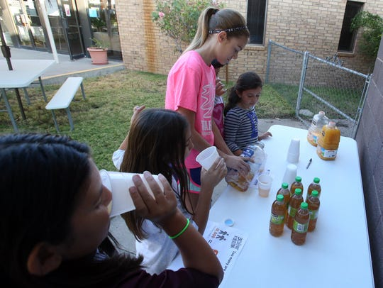 Young people at Mount Hope Lutheran Church drink water