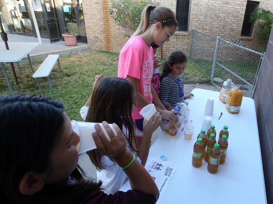 Young people at Mount Hope Lutheran Church drink water and juice during their more than 24-hour fasting period Sunday.