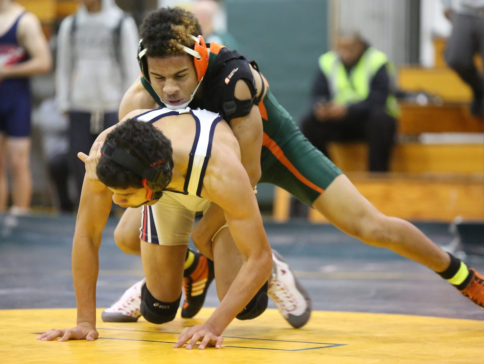 East Ramapo's Romello Bradley, top, wrestles Yonkers' Fredy Guevara in a 145-pound match during a quad meet in the Section 1 dual meet championships at Ramapo High School in Spring Valley on Wednesday, Dec. 2, 2015. East Ramapo defeated Yonkers 53-29 and advances to the semifinals.