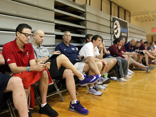 University of Louisville head basketball coach Rick Pitino, left, sits with fellow college coaches during Wednesday's Summer Icebreaker showcase at Philadelphia University. The coaches were in attendance to watch some of the region's top prospects.