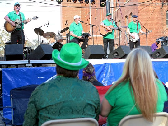 Members of Shannon Folk perform at the St. Patrick's Day Downtown Street Festival in 2016.