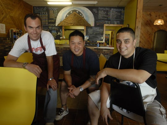 From left, Jeremy Thomas, Harold Klein, and Joshua Takahashi, co-owners of the Yellow Sub restaurant sit in the dining Wednesday July 20, 2011. They re-opened the restaurant after is was closed by former owner, Frank Gallagher.
