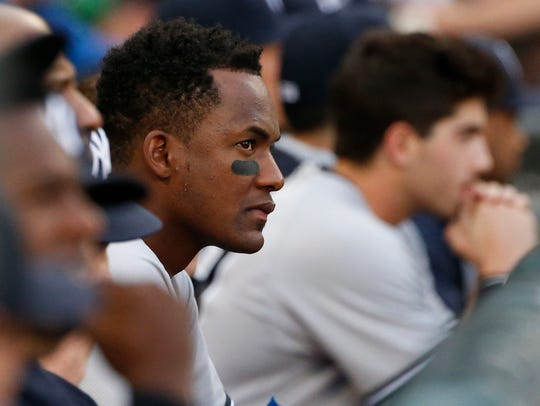 New York Yankees' Miguel Andujar watches teammates