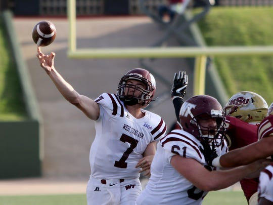 West Texas A&M quarterback Justin Houghtaling passes in the game against Midwestern State Saturday, Oct. 21, 2017, at Memorial Stadium in Wichita Falls.