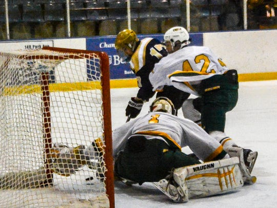 Roxbury's Billy Hefferle (17) beats Morris Knolls goaltender