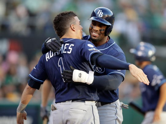 Rays' Yandy Diaz, right, is congratulated by Willy Adames after hitting a solo home run against the Athletics during the third inning Wednesday.