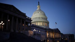 The U.S. Capitol is seen as lawmakers work to avert