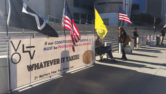 Supporters of Cliven Bundy and others charged in the Bundy Ranch case gather outside the U.S. District Courthouse in Las Vegas on March 2, 2017. Closing arguments are expected to begin in the trial of the first six defendants Wednesday, April 12, 2017.