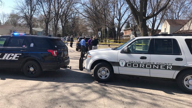 This photo provided by KVLY-TV/Fargo show authorities at the scene in Grand Forks, N.D., Thursday, May 3, 2018, after a police officer making a welfare check found four people, three elementary school children and a parent, dead inside a home. Administrators at Lewis and Clark Elementary School asked for the check on the home on the city's south side.