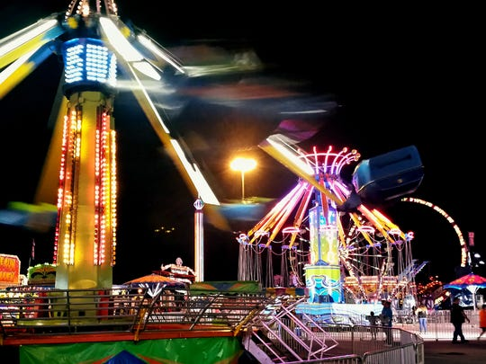 """Midway rides spin fairgoers Thursday September 17, 2015.  Some specialty foods from last year's York Fair will be featured Thursday on an episode of the Cooking Channel's show """"Carnival Eats."""" John A. Pavoncello - jpavoncello@yorkdispatch.com"""