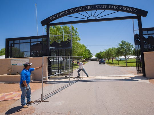 Workers set up fencing at the gate to the Southern New Mexico State Fairgrounds on Thurday,, May 26, 2016, as part of the preparation for the upcoming Southern New Mexico Wine Festival.