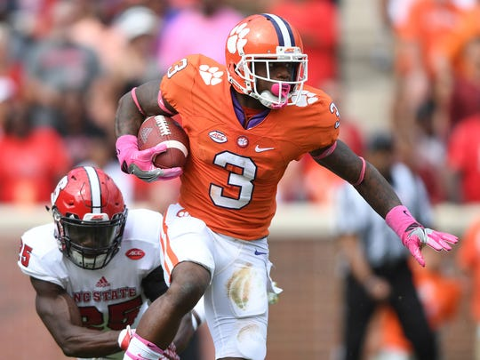 Clemson wide receiver Artavis Scott (3) runs  past North Carolina State cornerback Sean Paul (25) during the third quarter of a game on Oct. 15.
