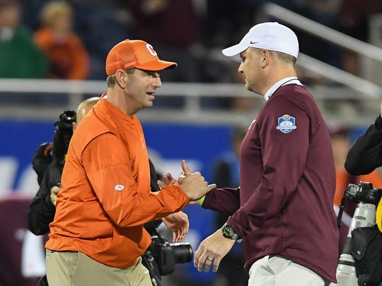 Clemson head coach Dabo Swinney and Virginia Tech head coach Justin Fuente during pregame of the ACC Championship at Camping World Stadium in Orlando on Saturday, December 3, 2016.