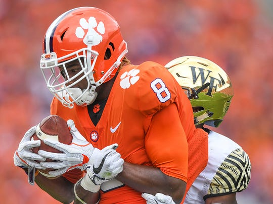 Clemson wide receiver Deon Cain (8) makes a reception past Wake Forest defensive back Ja'Sir Taylor (24) during the 3rd quarter on Saturday, October 7, 2017 at Clemson's Memorial Stadium.
