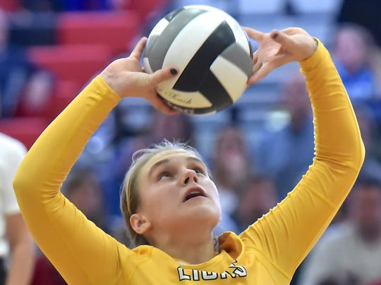 Ursuline's Logan Case sets the volleyball to a teammate