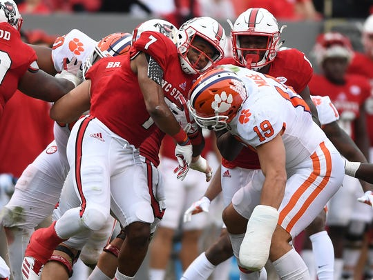Clemson defensive back Tanner Muse (19) tries to stop