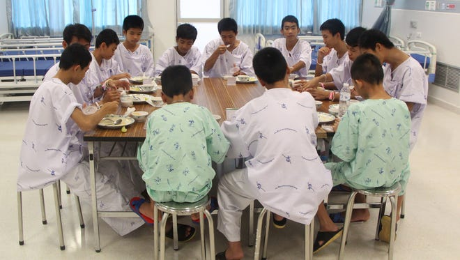 A handout photo made available by the Chiang Rai Prachanukroh Hospital and the Ministry of Public Health shows some of the 13 rescued soccer team members having a meal together in Chiang Rai province, Thailand on July 14.