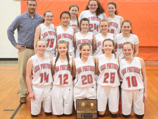 Members of the Norfork Lady Panthers pose with their