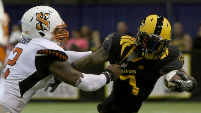 Wichita Falls Nighthawks' Troy Evans Jr. is tackled by Spokane Empire's Toby Jackson Friday, March 3, 2017, at Kay Yeager Coliseum.