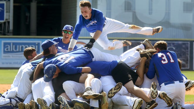 CAK's Alex Osborne (4) jumps on the top of the dog pile after beating CPA to win the Class AA Baseball State Championship at Spring Fling on Friday, May 26, 2017.