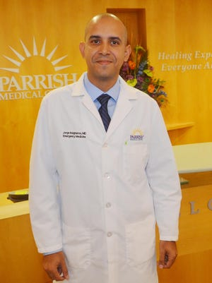 Dr. Jorge Insignares is an ER doctor at Parrish Medical Center in Titusville