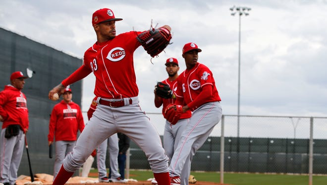 Cincinnati Reds pitcher Vladimir Gutierrez (83) and Cincinnati Reds relief pitcher Raisel Iglesias (26) throws in the bullpen during Cincinnati Reds spring training, Saturday, Feb. 18, 2017, at the Cincinnati Reds player development complex in Goodyear, Arizona.