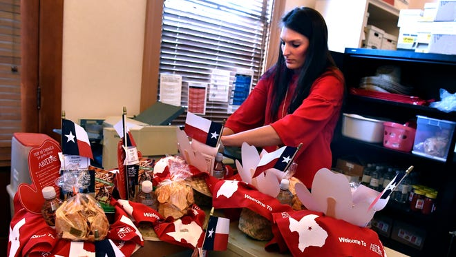 Tiffany Nichols, the visitor services manager for the Abilene Convention and Visitors Bureau assembles VIP hats on April 4. The gift assortments are made up of products made in Texas and Abilene.