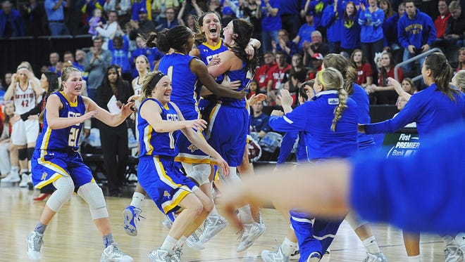 SDSU players celebrate their 61 to 55 win over USD in the Summit League women's basketball tournament championship game Tuesday, March 8, 2016, at the Denny Sanford Premier Center in Sioux Falls.