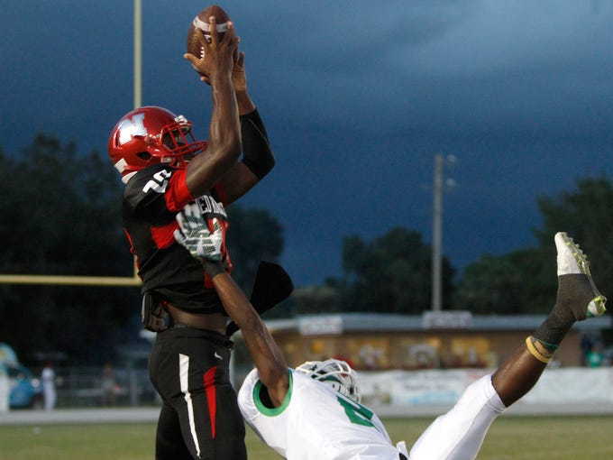 North Fort Myers receiver Austin Watkins goes up against