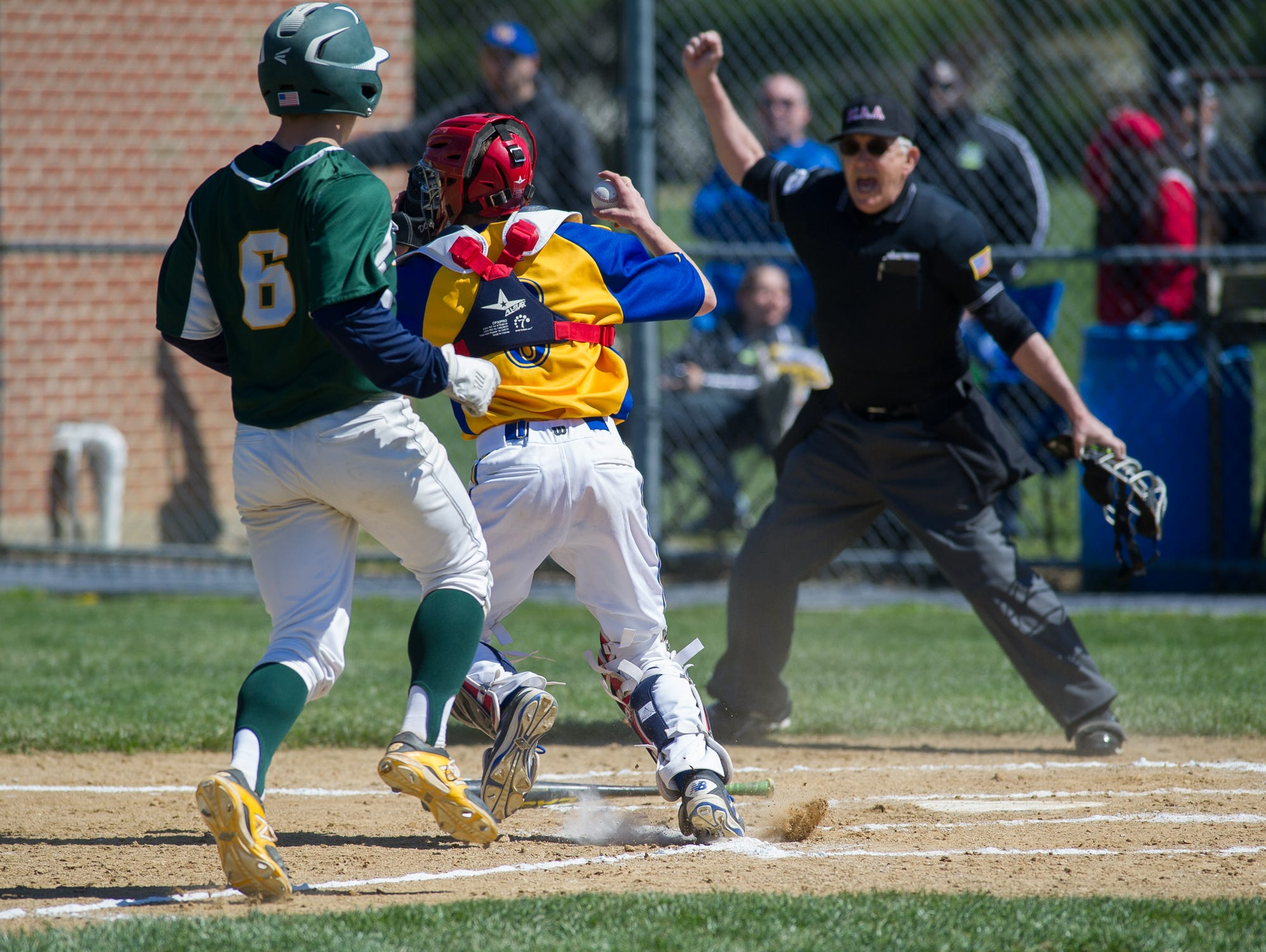 Caesar Rodney's catcher Blake Donovan (8) tags St. Mark's Tom Reich (6) out at home plate.