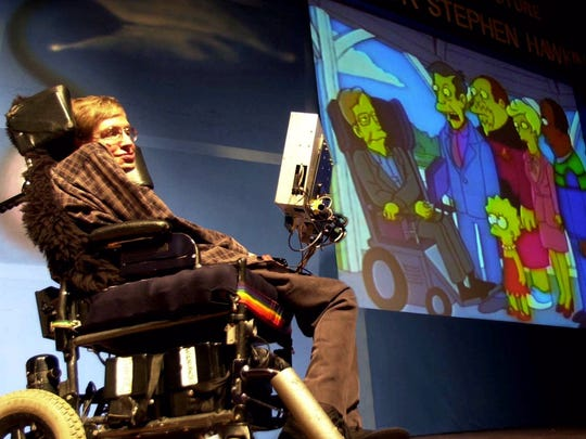 British physicist Stephen Hawking looks, on his screen,