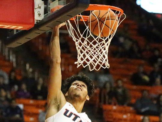 UTEP's Paul Thomas dunks the ball Tuesday night.