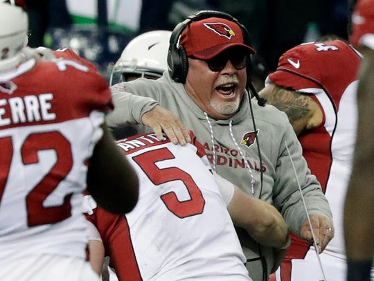 Arizona Cardinals head coach Bruce Arians is hugged