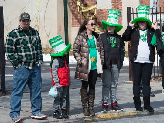 Karlee McGinnis (center) was one of the people on the scene when former judge Don Callender collapsed during Wilmington's St. Patrick's Day parade. The nurse's quick action, along with the help of others, saved the man's life.