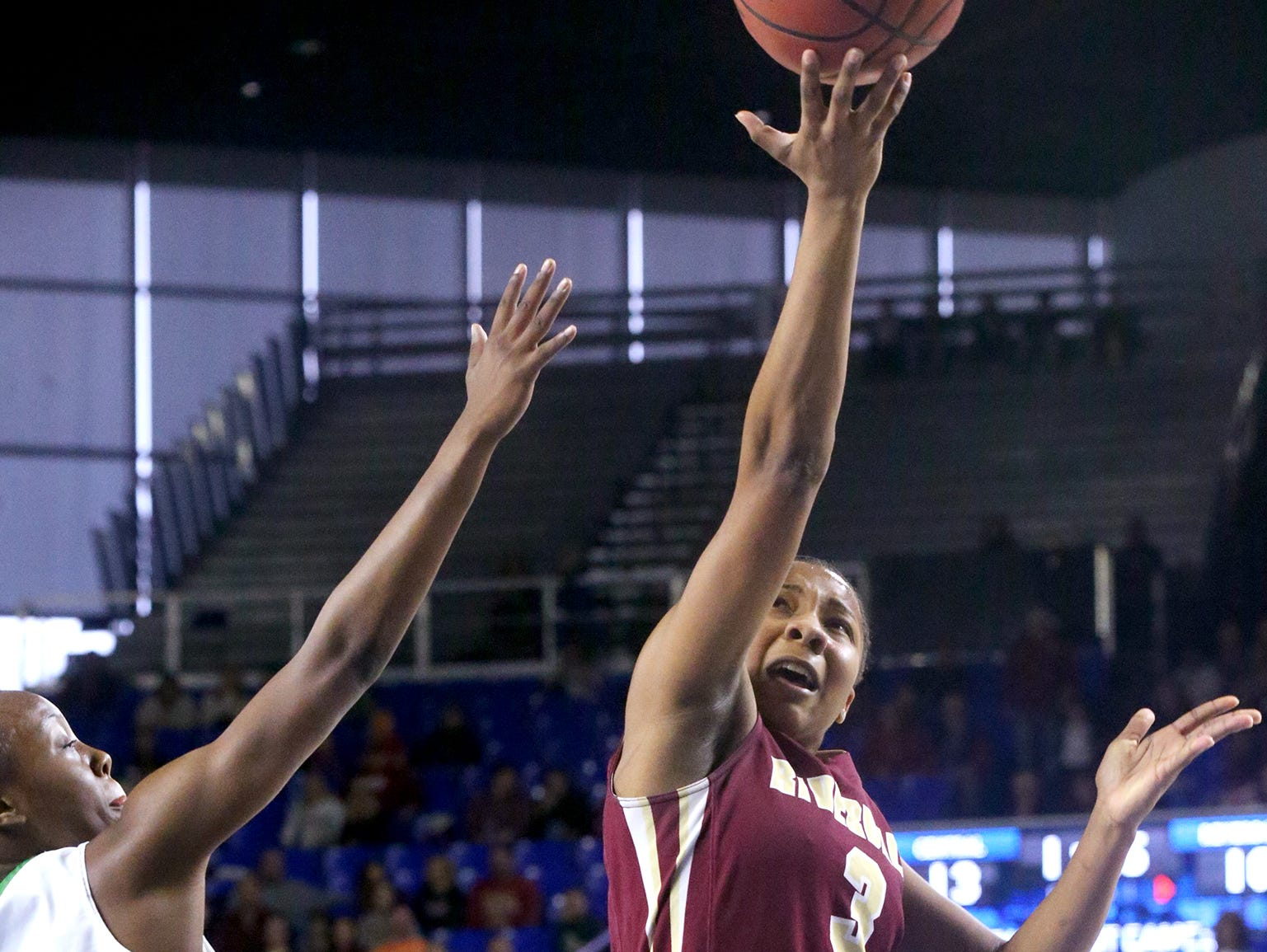 Riverdale's Anastasia Hayes (3) goes up for a shot against Memphis Central's Johne' Stewart (15) guards her during the Championhip game of the Class AAA State Tournament on Saturday, March 11, 2017.