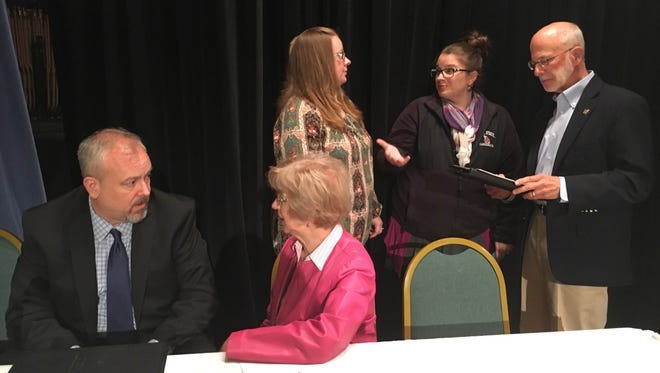 Panelists Rep. Sue Errington, Rep. Greg Beumer and superintendent Steven Baule talk with each other and community members after talking about ISTEP during a public forum April 23.